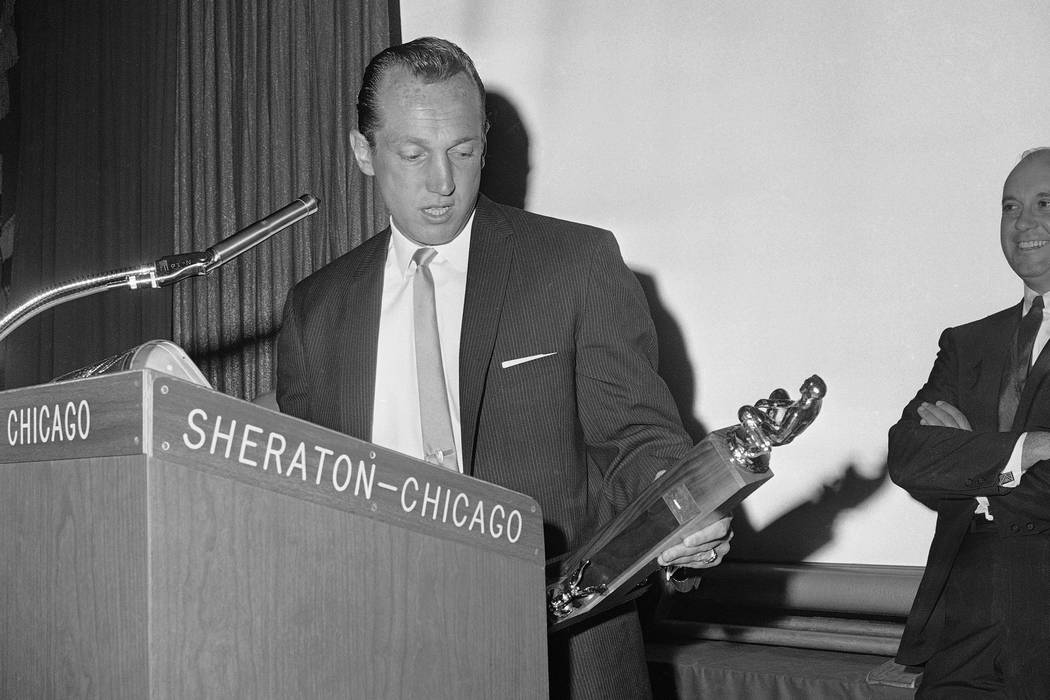 Coach Al Davis of the Oakland, California, Raiders of the American Football League holds trophy awarded him, May 29, 1964 by magazine (Pro Football Illustrated) as coach of the year in the league. ...
