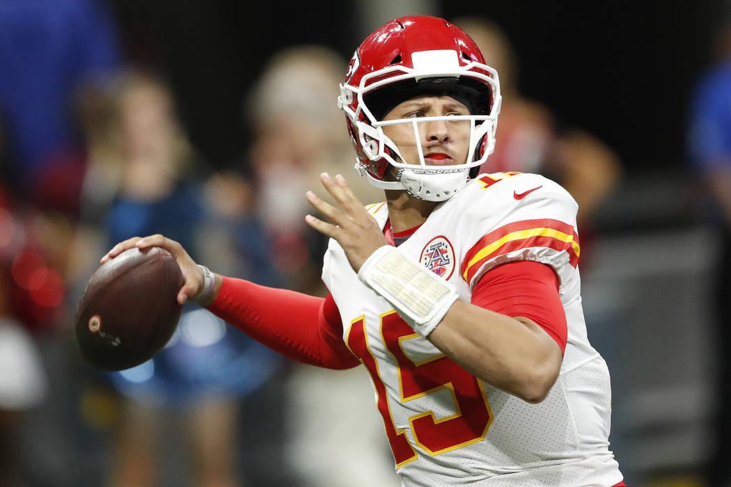 Kansas City Chiefs quarterback Patrick Mahomes (15) works against the Atlanta Falcons during the first half of an NFL preseason football game, Friday, Aug. 17, 2018, in Atlanta. (AP Photo/John Baz ...