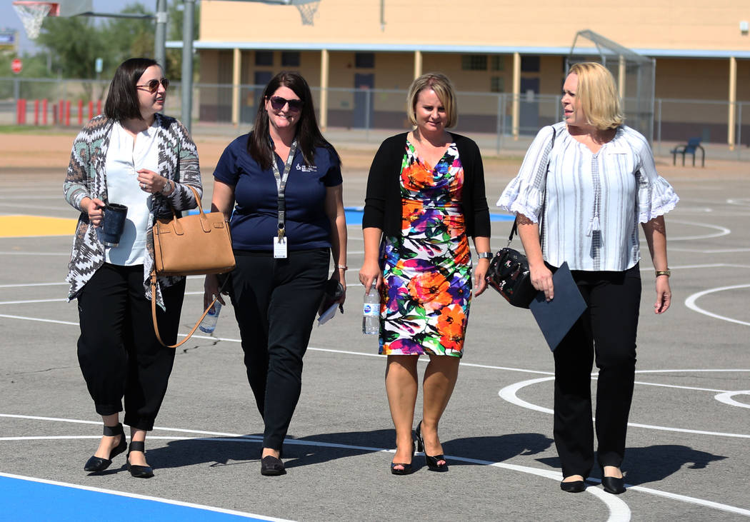 Misha Ray, left, marketing manager at Communities In Schools (CIS), Meghan Vargo, site coordinator at CIS Kimberly Basham, Robert Taylor Elementary School principal, and Jennifer Bulloch, right, p ...