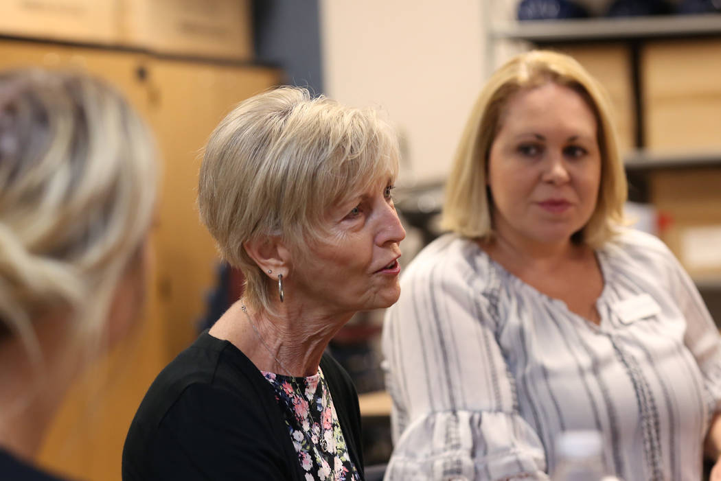 Cheri Ward, center, executive director of Communities In Schools (CIS) of Southern Nevada, speaks as Jennifer Bulloch, program director at CIS, Looks on during an interview with the Las Vegas Revi ...