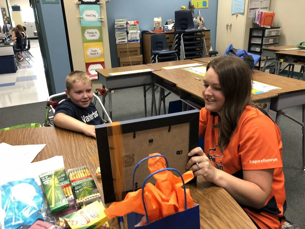 "Seven-year-old Dylan Chalmers, a second-grade student with cerebral palsy, was recently named an Apex Fun Run ""strong kid. Dylan received his award at Vanderburg ..."