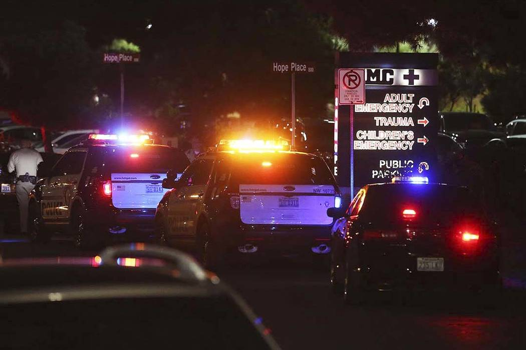 Officers are present outside University Medical Center's Trauma Center on Charleston Boulevard in Las Vegas, Sunday, Oct. 1, 2017. Bridget Bennett Las Vegas Review-Journal @Bridgetkbennett