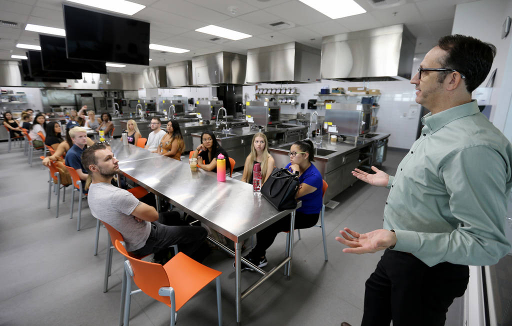 Todd Uglow, right, teaches Special Events Management class in the Marriott Executive Kitchen in Hospitality Hall at UNLV Thursday, Aug. 30, 2018. K.M. Cannon Las Vegas Review-Journal @KMCannonPhoto