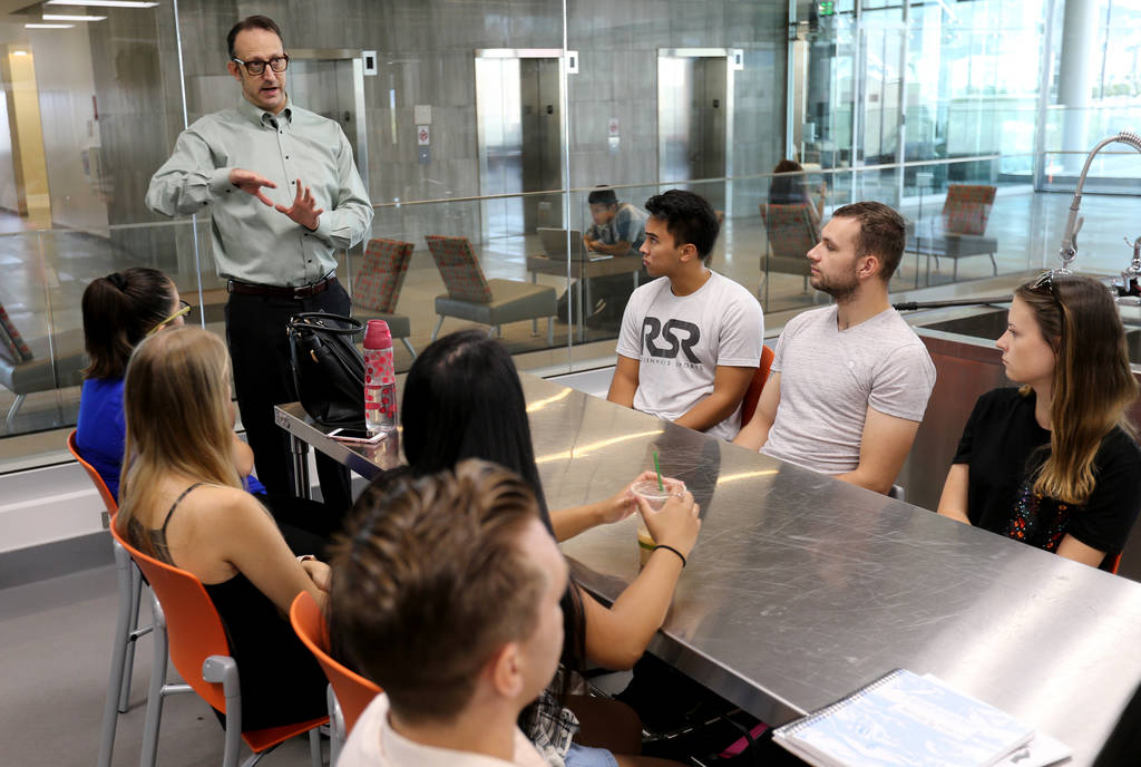 Todd Uglow, top, teaches Special Events Management class in the Marriott Executive Kitchen in Hospitality Hall at UNLV Thursday, Aug. 30, 2018. K.M. Cannon Las Vegas Review-Journal @KMCannonPhoto