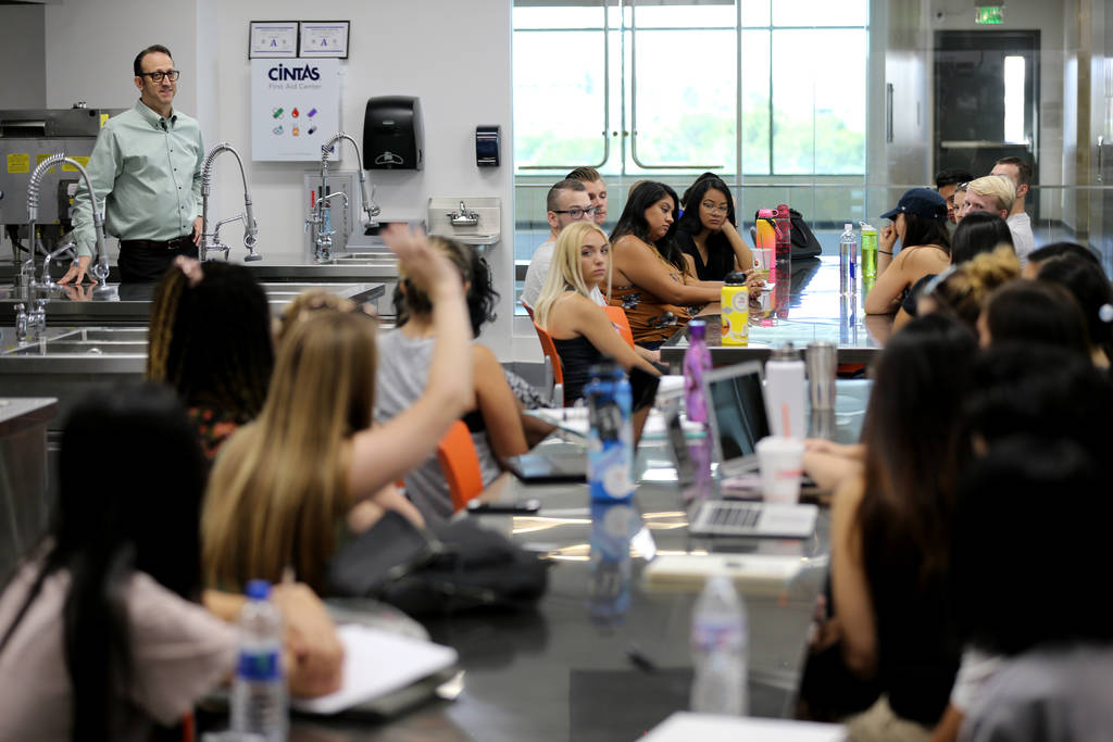 Todd Uglow, top left, teaches Special Events Management class in the Marriott Executive Kitchen in Hospitality Hall at UNLV Thursday, Aug. 30, 2018. K.M. Cannon Las Vegas Review-Journal @KMCannonPhoto