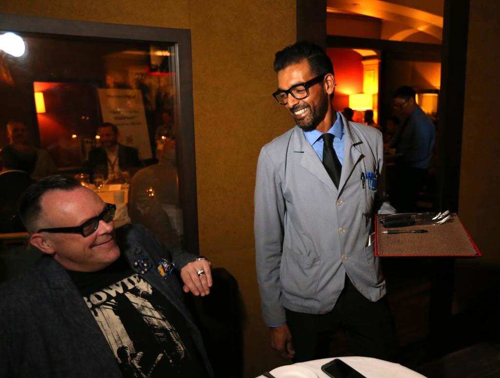Captain server Yash Gokul visits with regular customer Neil Fredrick at Charlie Palmer Steak at the Four Seasons in Las Vegas Tuesday, Aug. 28, 2018. K.M. Cannon Las Vegas Review-Journal @KMCannon ...