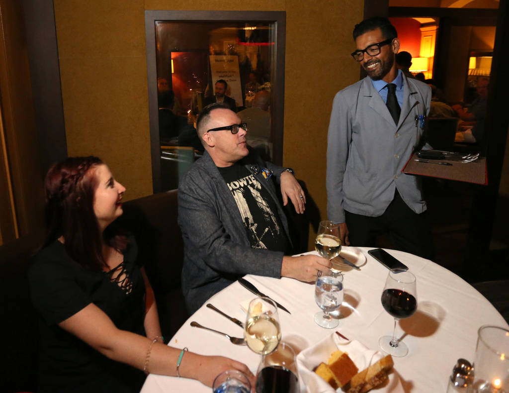 Captain server Yash Gokul visits with regular customers Madeleine Koster and Neil Fredrick at Charlie Palmer Steak at the Four Seasons in Las Vegas Tuesday, Aug. 28, 2018. K.M. Cannon Las Vegas Re ...