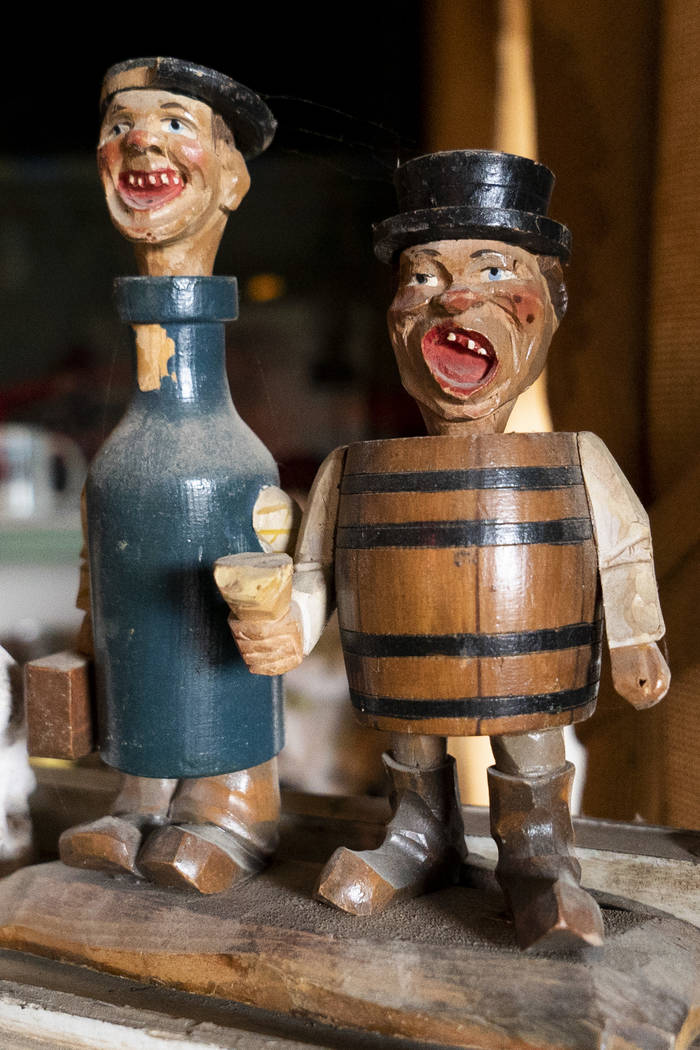 Two wooden figurines photographed in Walt Kremin's saloon at Gold Point, Tuesday, Sept. 4, 2018. After a decades long property dispute, the Bureau of Land Management has announced plans to transfe ...