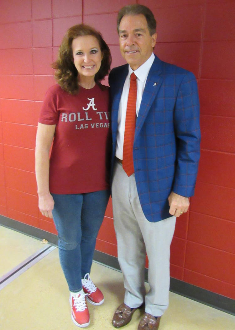 Cancer survivor Janet King poses with University of Alabama football coach Nick Saban. Courtesy of Janet King.