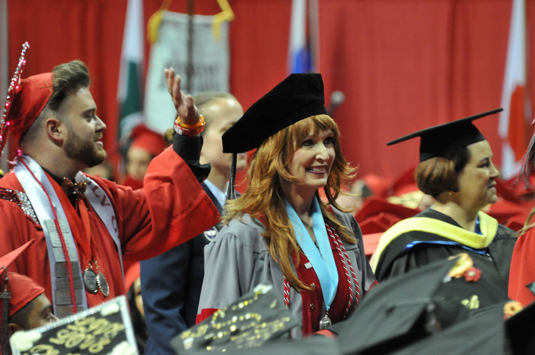 Janet King, 54, who had stage 3 lung cancer, walks to the stage May 13, 2017, at the Thomas & Mack Center to receive her doctorate at UNLV's spring commencement ceremony. (Jeff Mosier/View)