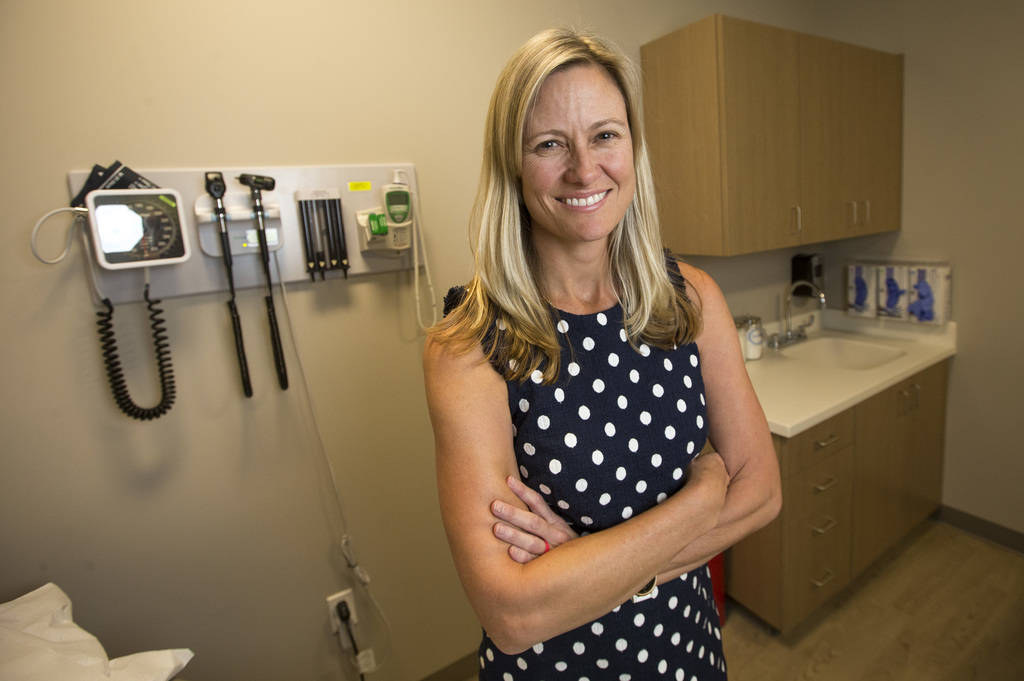 Dr. Leslie Keck, internal medicine specialist for HealthCare Partners Nevada, poses in an examination room at myGeneration, a senior-focused health clinic for people on Medicare, at the clinics' o ...