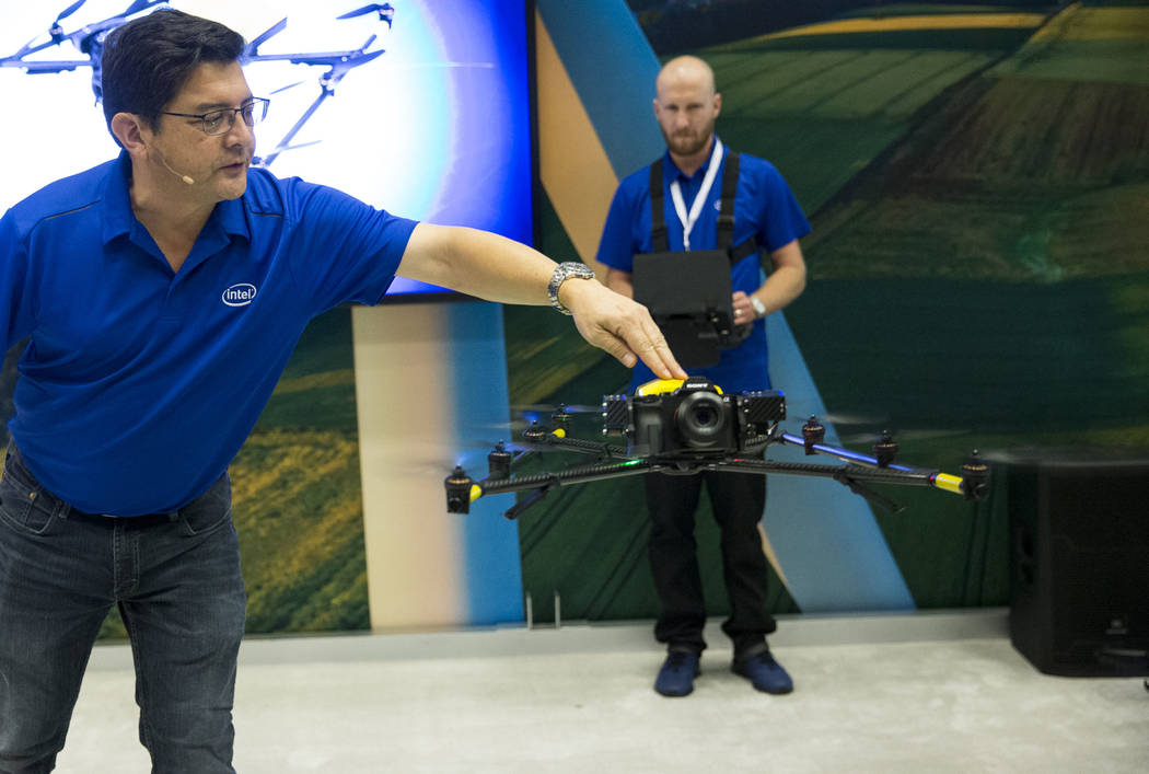 Jeffrey Lo, left, marketing manager for Intel and pilot Andrew Georgopoulos, give a demonstration of the Intel Falcon 8+ drone during the InterDrone conference at the Rio Convention Center in Las ...