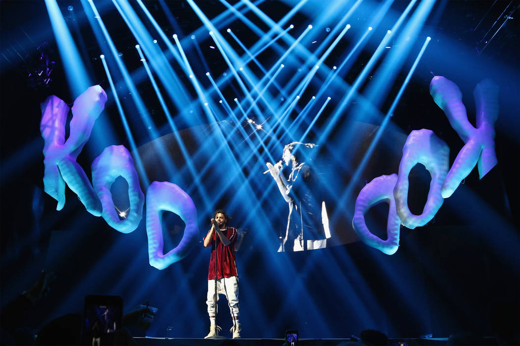 """J. Cole performs on stage for his """"KOD"""" Tour Opener at American Airlines Arena on August 9, 2018 in Miami, Florida. (Photo by John Parra/Getty Images for Live Nation)"""
