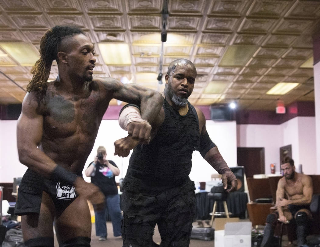 """Chris Bey, left, practices with Wes Logan, aka """"Beast the Butcher"""" before the start of their Versus Wrestling match on Friday, Aug., 3, 2018, at Neonopolis, in Las Vegas. Benjamin Hager ..."""