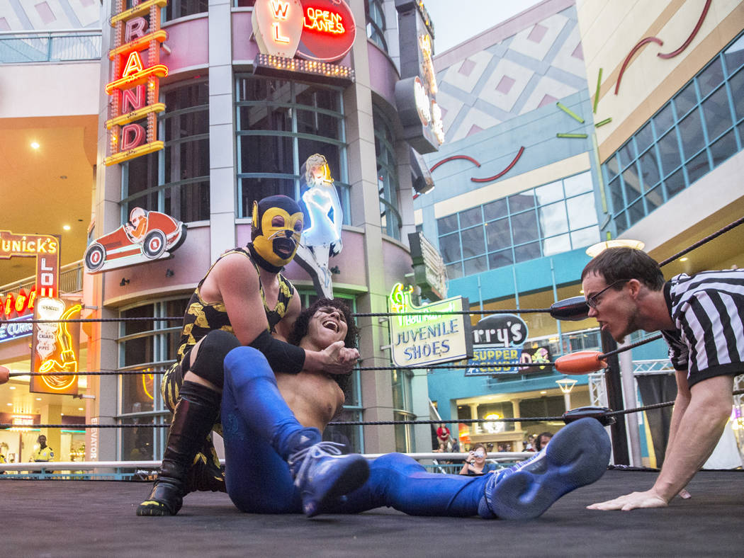 """Austin Goodfield, left, aka """"Macho Mouse,"""" puts """"Vincent Pride"""" in a headlock during a Versus Wrestling event on Friday, Aug., 3, 2018, at Neonopolis, in Las Vegas. Benjamin Ha ..."""