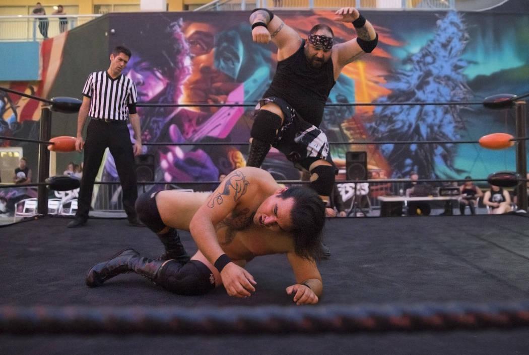 "Brandon Gregory, top, aka ""Death Collector Big Dirty,"" wrestles Tyler Seifert, aka ""Tyler J. Wildhorse,"" during a Versus Wrestling event on Friday, Aug., 3, 2018, at Neonopolis ..."