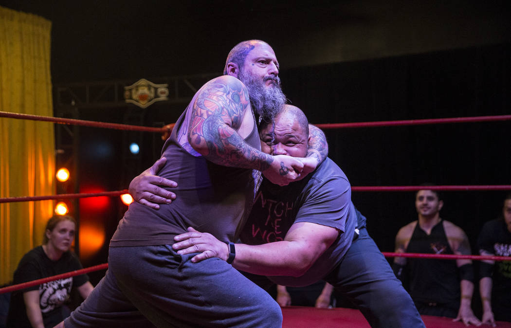 Former pro wrestlers Sinn Bodhi, left, and D. Lo Brown demonstrate a move to students at The Snake Pit Pro Wrestling Academy on Tuesday, March 6, 2018, in Las Vegas. Benjamin Hager Las Vegas Revie ...