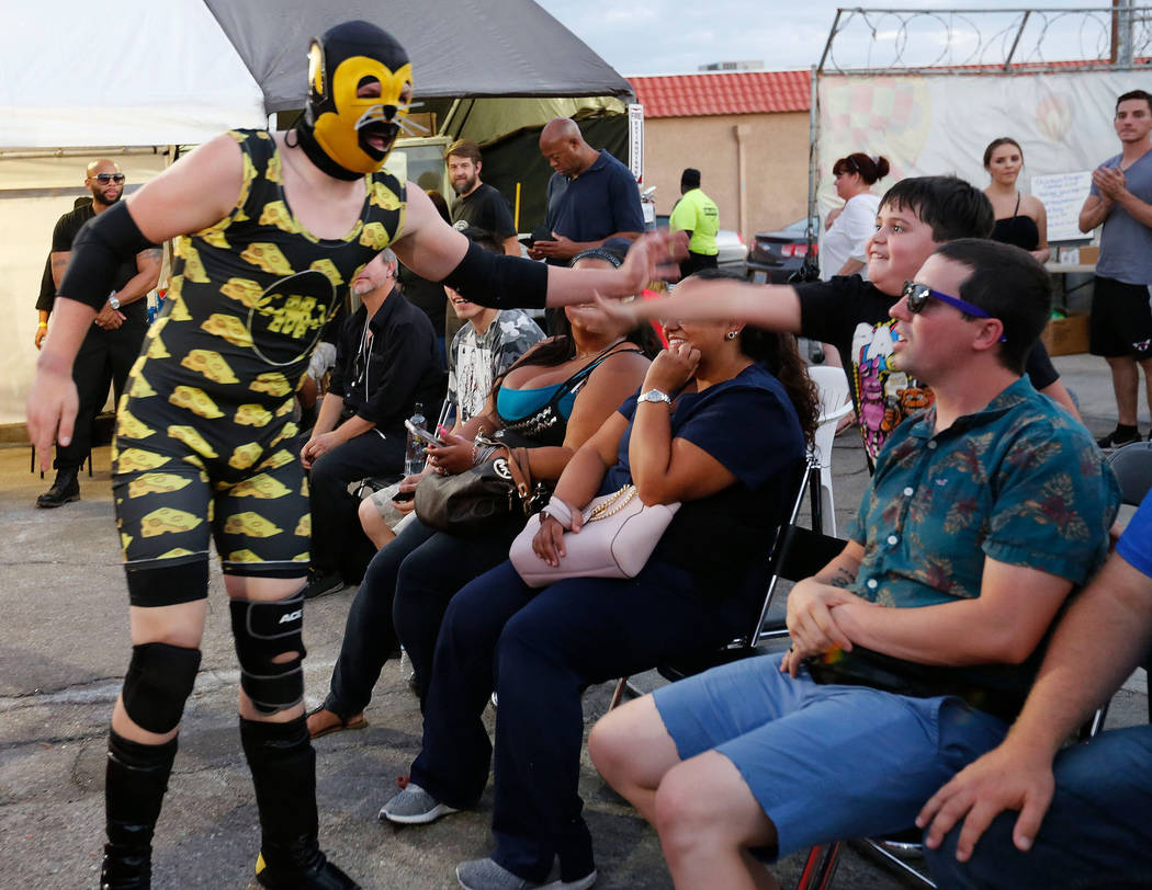 Macho Mouse gets a high-five after his fight during a Versus Pro Wrestling event at 1429 S. Commerce St. in Las Vegas, Friday, July 6, 2018. Chitose Suzuki Las Vegas Review-Journal @chitosephoto
