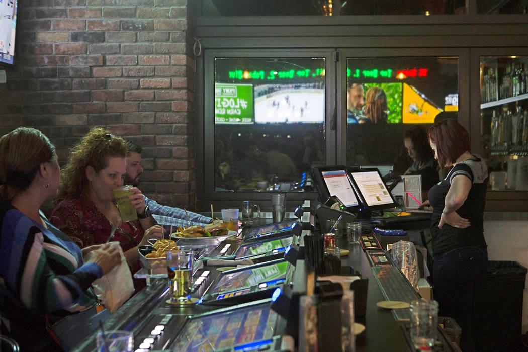 Patrons enjoy their drinks at PKWY Tavern on Friday, Feb. 10, 2017, in Las Vegas. (Bridget Bennett/Las Vegas Review-Journal) @bridgetkbennett