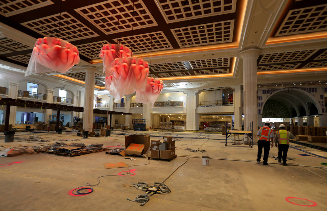 Greg John, executive director of brand marketing, right, gives a tour of the main casino floor of Encore Boston Harbor in Everett, Mass. Friday, Aug. 24, 2018. The resort, scheduled to open June 2 ...
