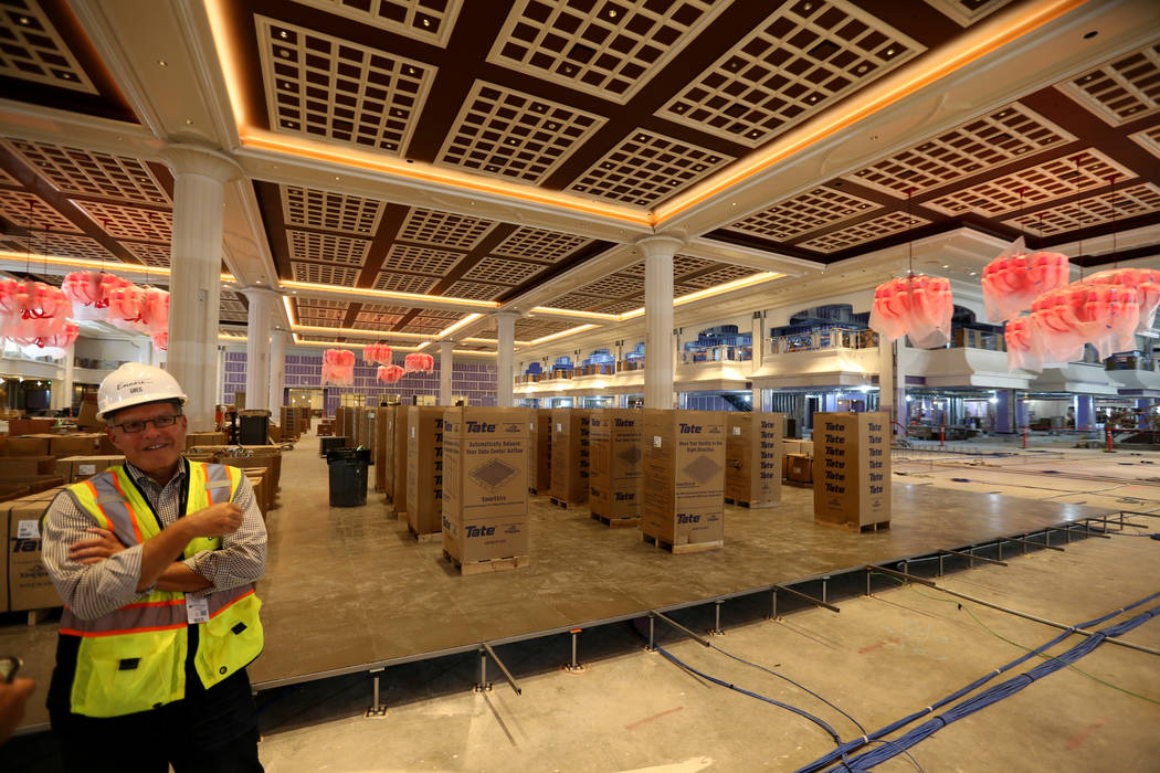 Greg John, executive director of brand marketing, gives a tour of the main casino floor of Encore Boston Harbor in Everett, Mass. Friday, Aug. 24, 2018. The resort, scheduled to open June 2019, wi ...