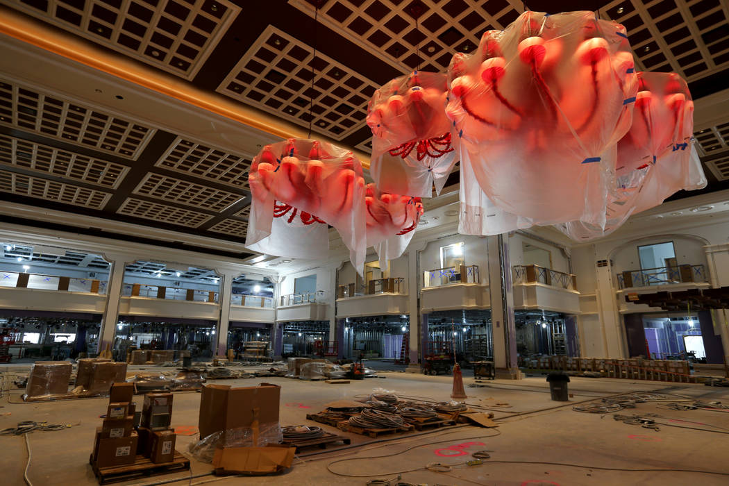 The main gaming floor of Encore Boston Harbor in Everett, Mass. Friday, Aug. 24, 2018. The chandeliers, hand-blown from Italy and infused with gold dust, were moved from Encore Las Vegas. K.M. Can ...