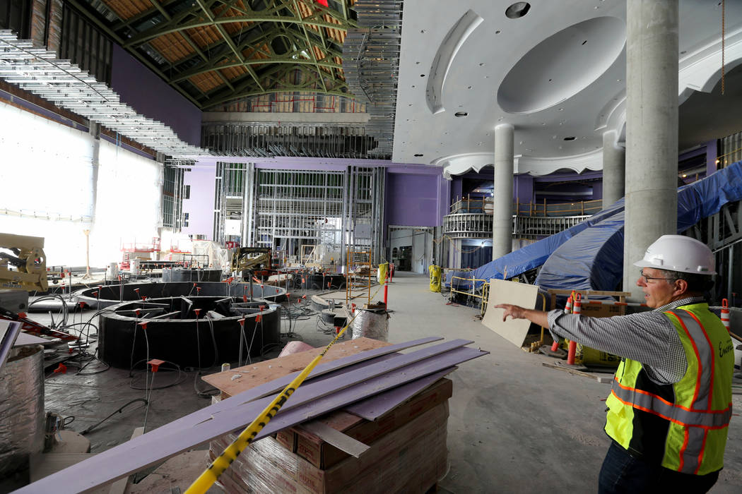 Greg John, executive director of brand marketing, gives a tour of the main lobby of Encore Boston Harbor in Everett, Mass. Friday, Aug. 24, 2018. The atrium will have natural sunlight to help with ...