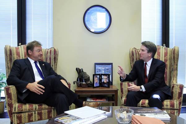 Supreme Court nominee Brett Kavanaugh, right, meets Sen. Dean Heller, R-Nev., on Capitol Hill in Washington, Thursday, July 19, 2018. (AP Photo/Manuel Balce Ceneta)