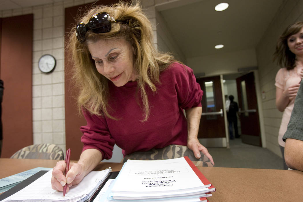 Sandra Gold of Las Vegas, signs in for a weekly foreclosure mediation class that is taught by students at the William S. Boyd School of Law at UNLV Thursday, Feb. 25, 2010. (K.M. Cannon/Las Vegas ...
