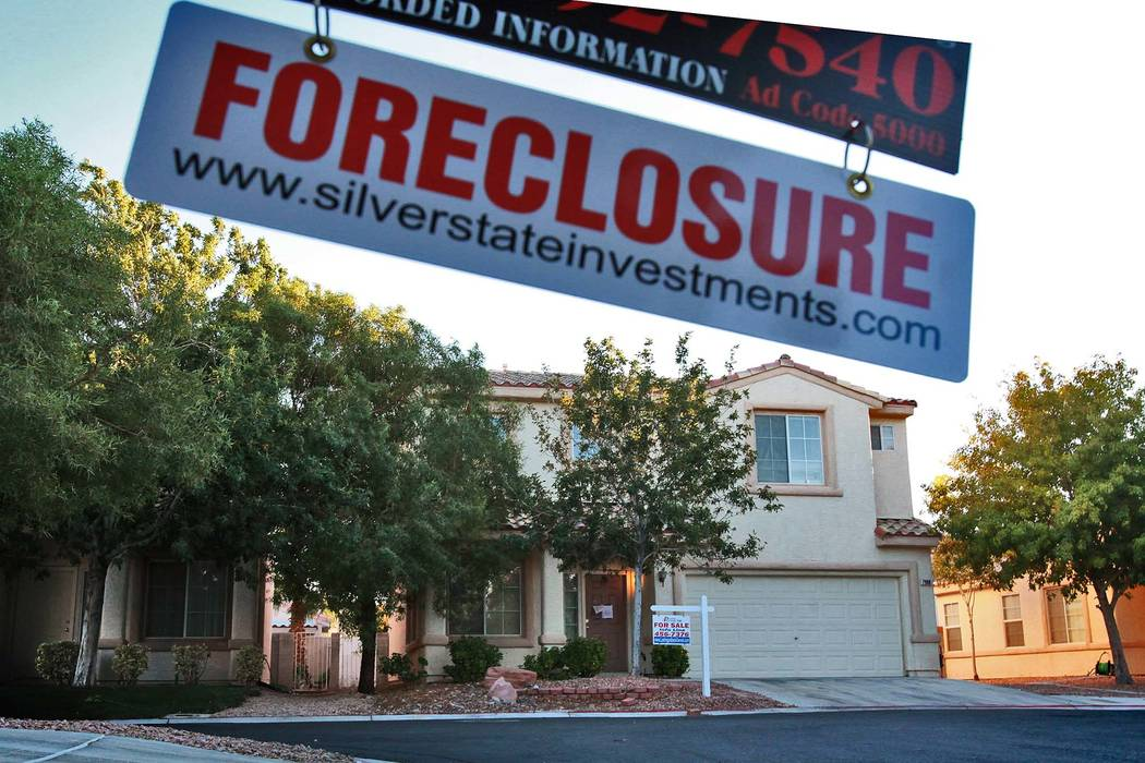 A foreclosure hanger swings from a real estate sign in the North Horn Trail Court neighborhood on Monday, Nov. 8, 2010. (File Photo)
