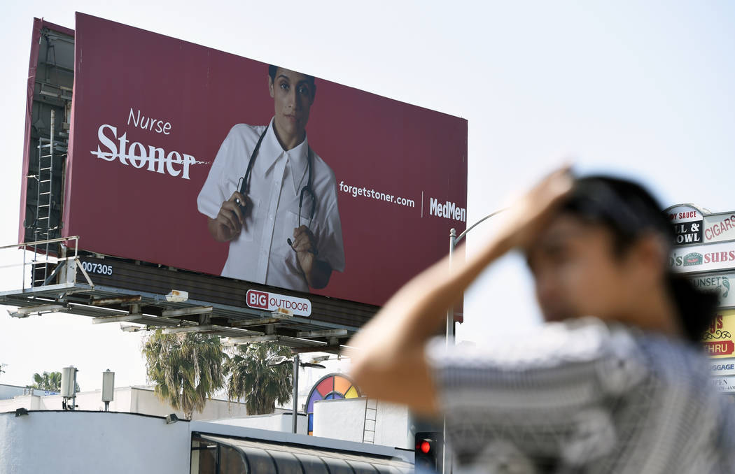 A billboard for MedMen, a marijuana dispensary, is seen at an intersection in Los Angeles in May 2018. (AP Photo/Chris Pizzello)