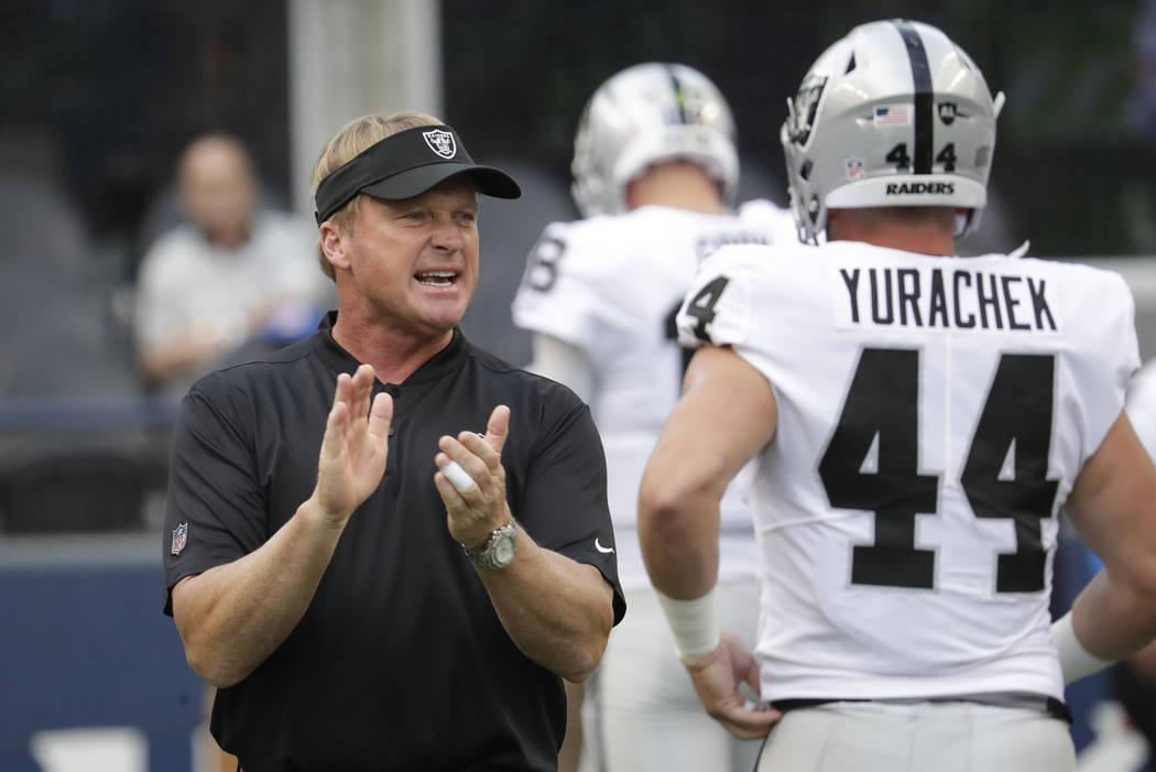 Oakland Raiders head coach Jon Gruden calls to his team as he stands next to running back Ryan Yurachek (44) before an NFL football preseason game against the Seattle Seahawks, Thursday, Aug. 30, ...