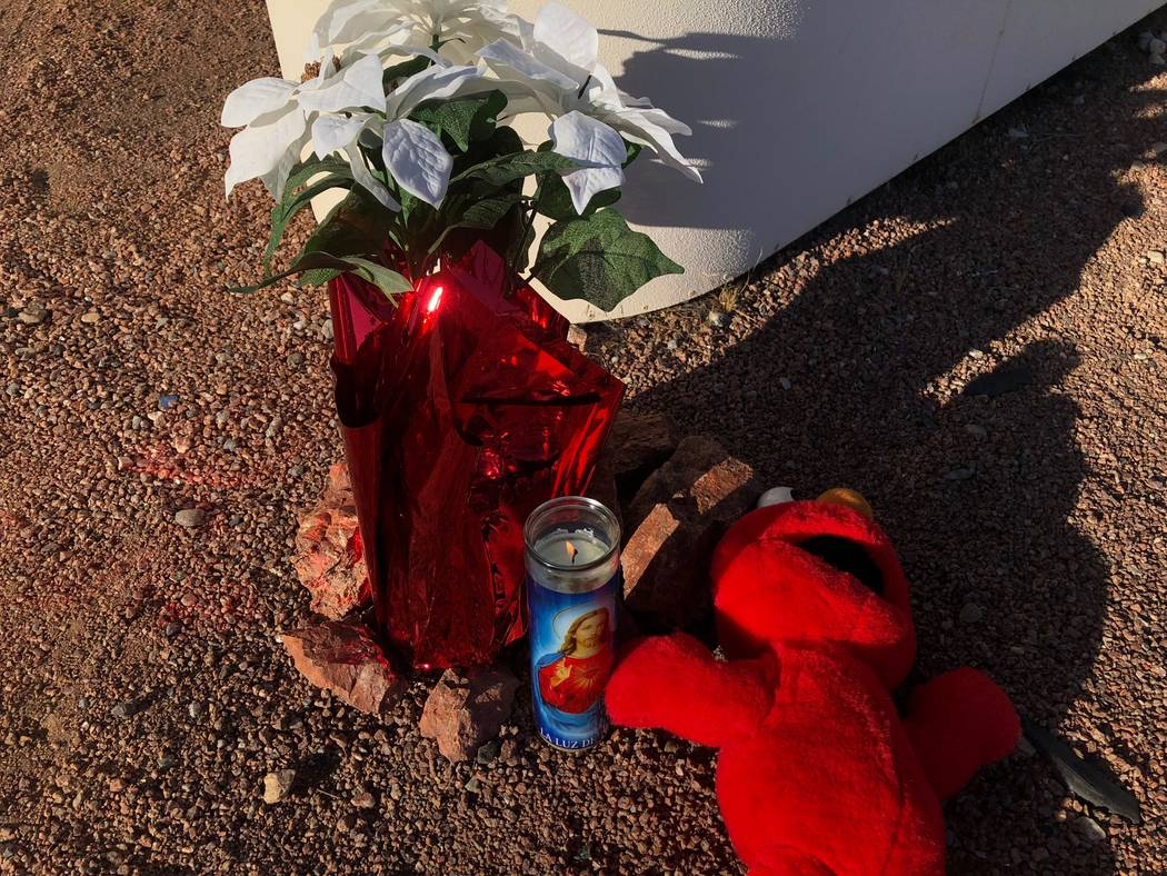 A makeshift memorial of flowers, an Elmo doll and a lit candle on Saturday morning marked the scene of the crash at the intersection of Eastern and Harmon avenues. Rio Lacanlale/Las Vegas Review-J ...