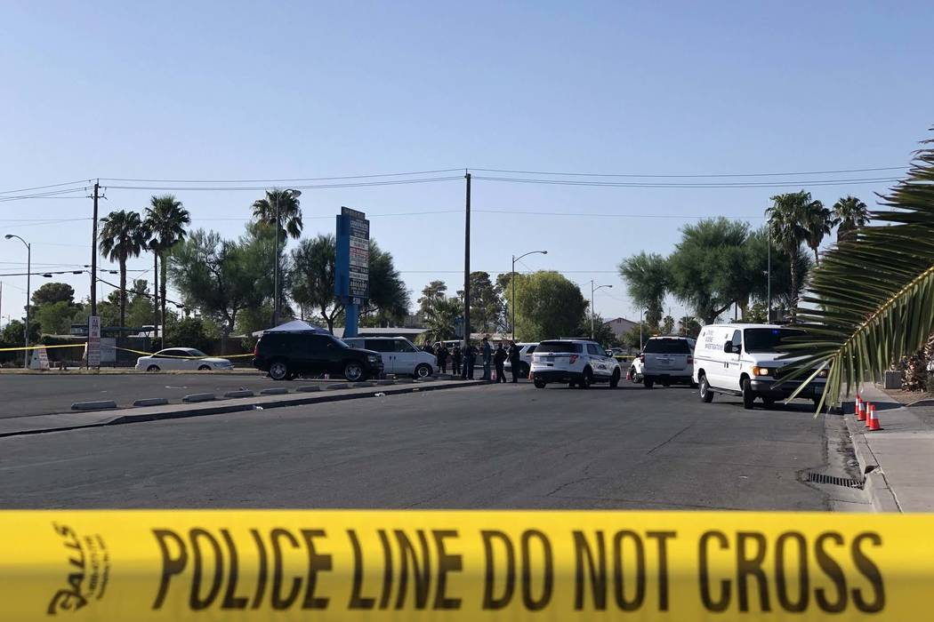 North Las Vegas police investigate the death of a man found in a utility van in a parking lot at East Lake Mead Boulevard and North McCarran Street, Sunday morning, Sept. 2, 2018. (Rio Lacanlale/L ...