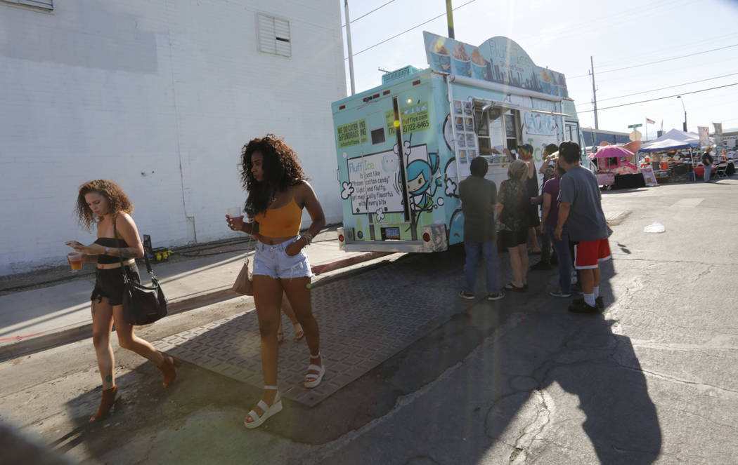 People walk by food trucks during First Friday Las Vegas, a monthly art festival, located in downtown Las Vegas Arts District, Friday, July 6, 2018. Chitose Suzuki Las Vegas Review-Journal @chitos ...