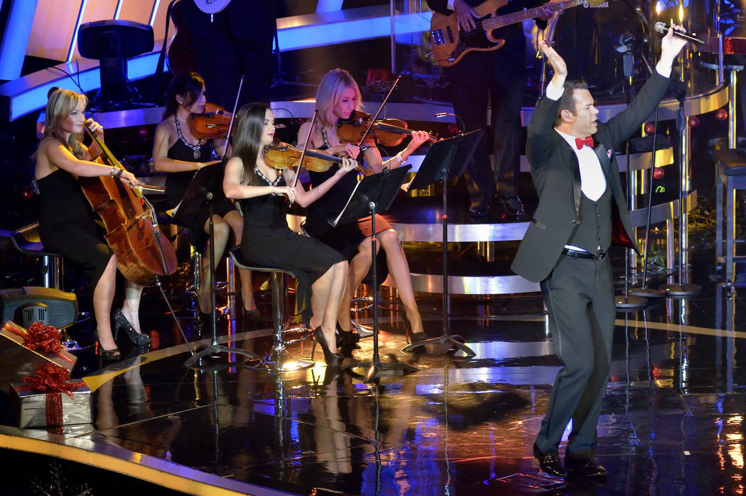 "Human Nature's Phil Burton performs with Bella Strings during the Human Nature ""Christmas, Motown and More"" in the Sands Showroom at The Venetian, Sunday, Dec. 14, 2014. (Bill Hughes/Las Vegas ..."