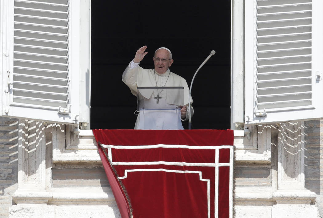 Pope Francis recites the Angelus noon prayer from the window of his studio overlooking St.Peter's Square, at the Vatican, Sunday, Sept. 2, 2018. (Alessandra Tarantino/AP)