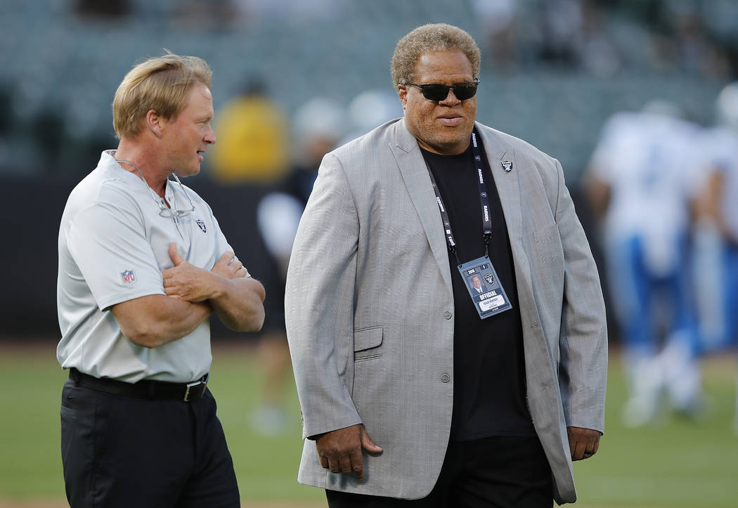 Oakland Raiders head coach Jon Gruden, left, and general manager Reggie McKenzie before an NFL preseason football game against the Detroit Lions in Oakland, Calif., Friday, Aug. 10, 2018. (AP Phot ...