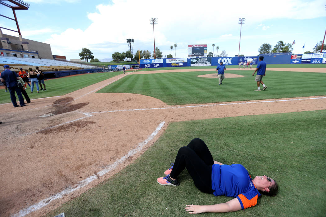 Director of Ticket Operations Siobhan Steiermann relishes the field after the Las Vegas 51s final game ever at Cashman Field in Las Vegas Monday, Sept. 3, 2018. The team will move to a new stadium ...