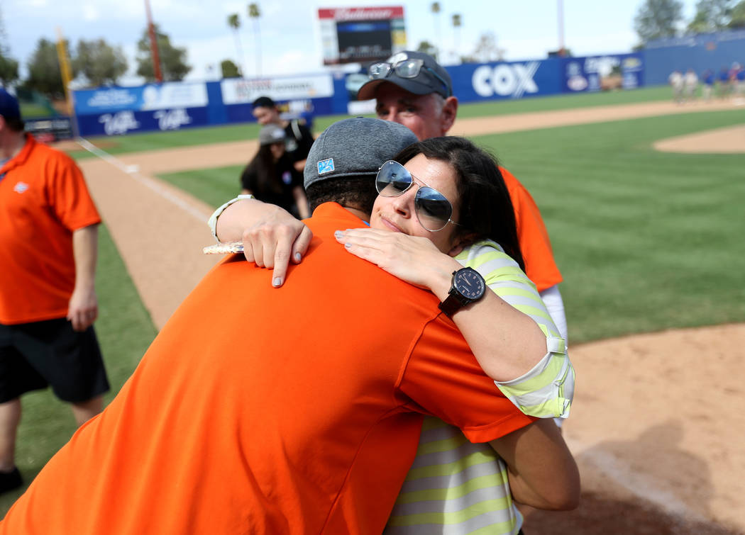 Vice President of Community Relations & Customer Experience Melissa Harkavy hugs Matthew Balthazar after the Las Vegas 51s final game ever at Cashman Field in Las Vegas Monday, Sept. 3, 2018. ...