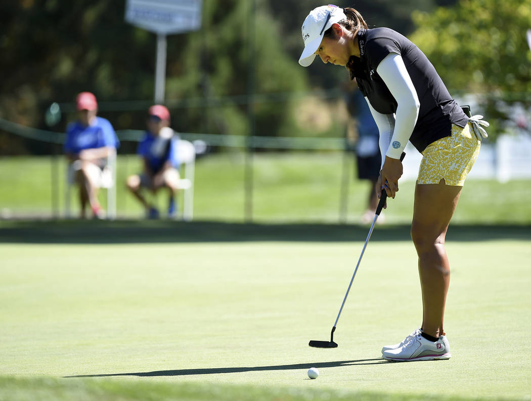 Marina Alex hits a putt on the first hole during the final round of the LPGA Cambia Portland Classic golf tournament in Portland, Ore., Sunday, Sept. 2, 2018. (AP Photo/Steve Dykes)