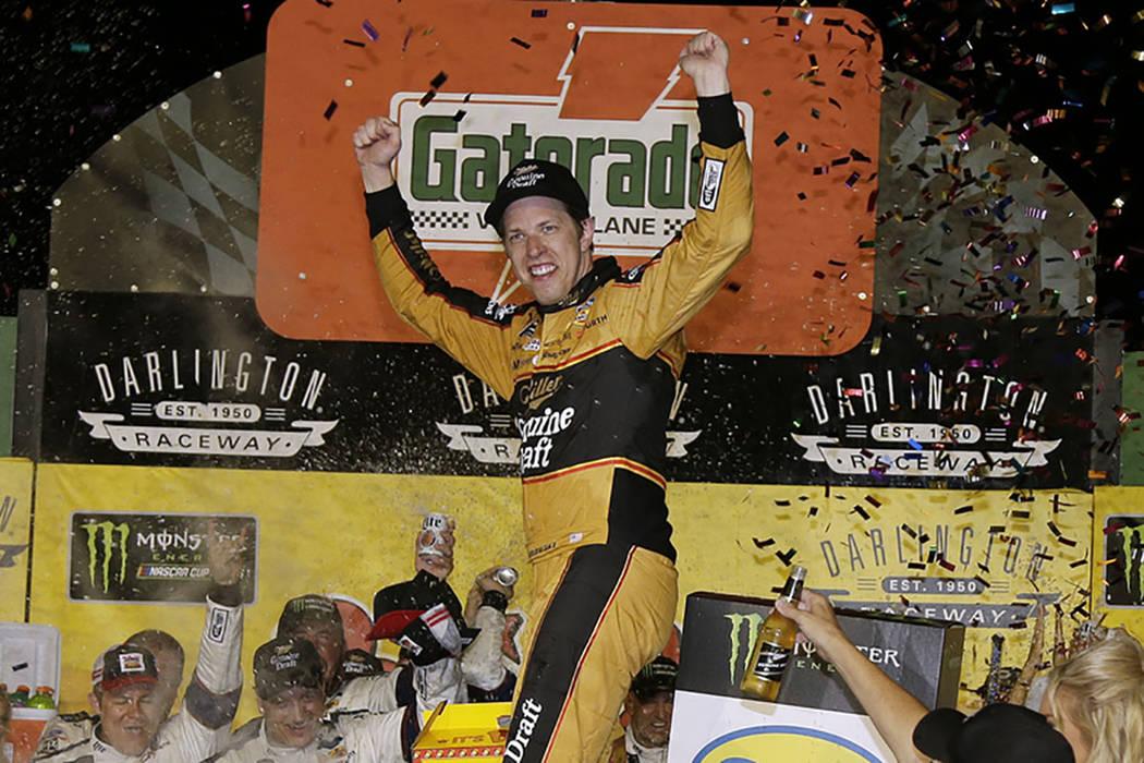 Brad Keselowski celebrates in Victory Lane after winning the NASCAR Cup Series auto race at Darlington Raceway, Sunday, Sept. 2, 2018, in Darlington, S.C. (AP Photo/Terry Renna)