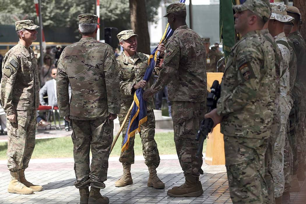 Incoming U.S. Army Gen. Austin Miller, center, receives a NATO flag from outgoing U.S. Army Gen. John Nicholson, second from left, during the change of command ceremony, at Resolute Support headqu ...