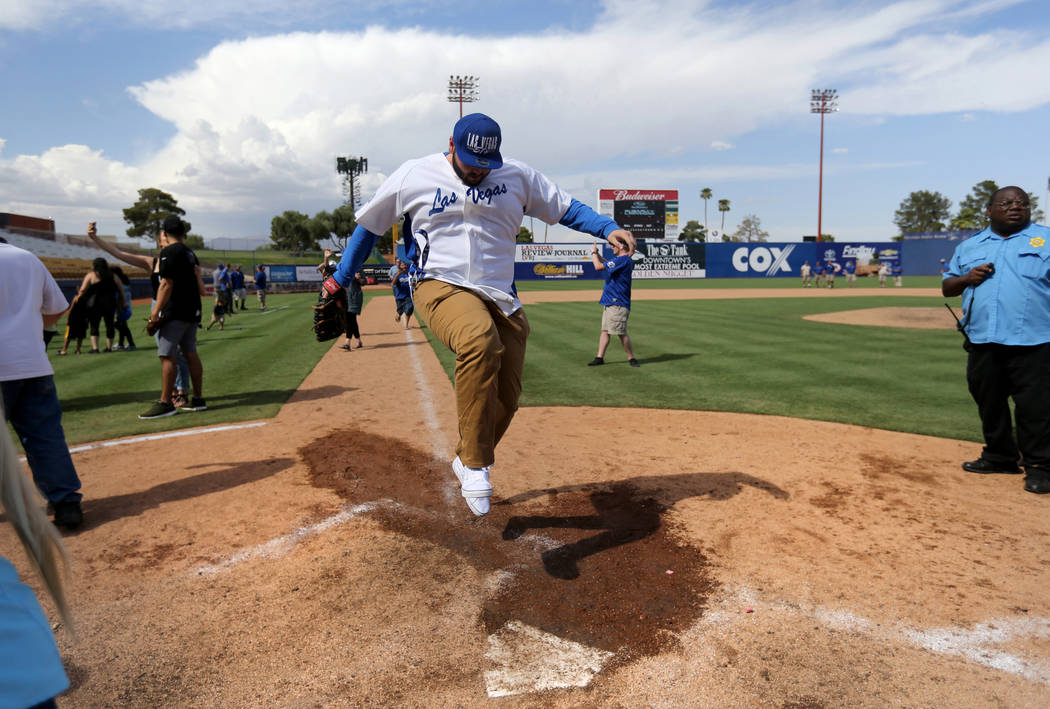 Las Vegas 51s fan Kendall Williamson jumps on home plate after running the bases after the final game ever at Cashman Field in Las Vegas Monday, Sept. 3, 2018. The team will move to a new stadium ...
