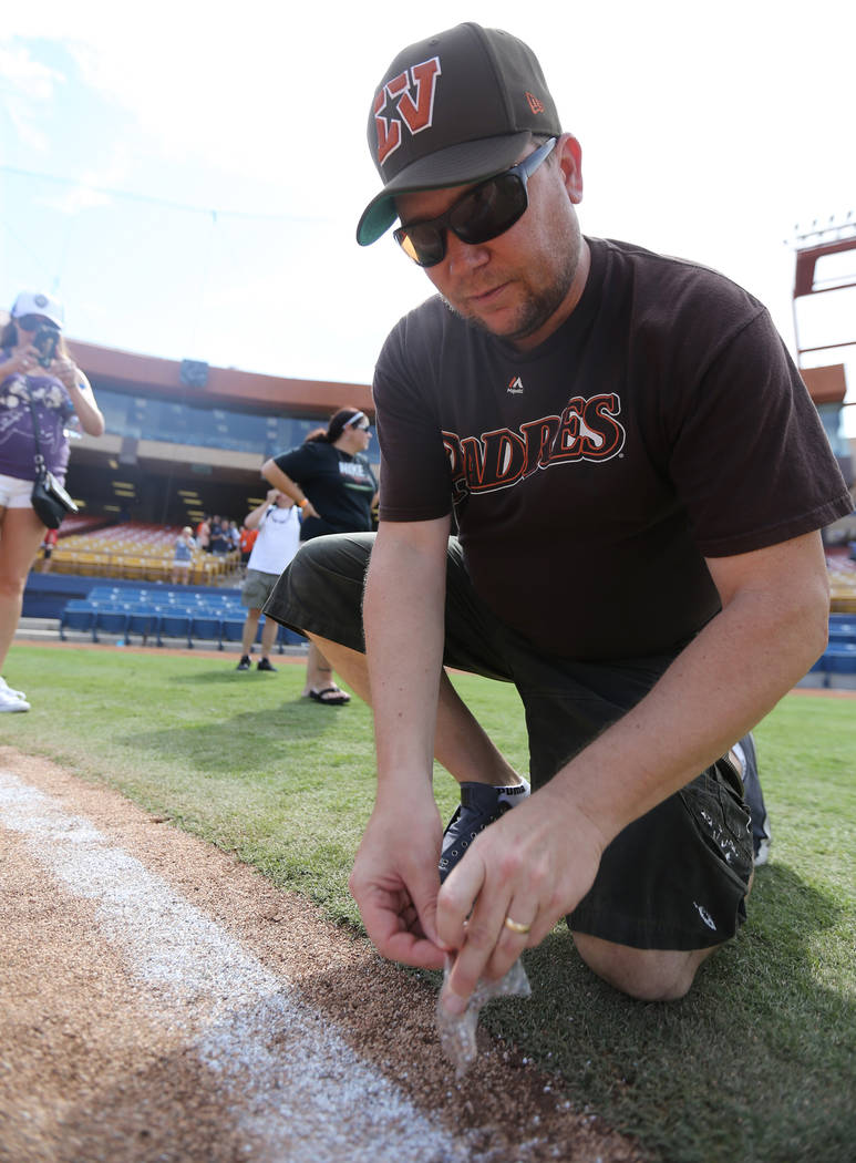 Mark Steele of Las Vegas gathers dirt after the Las Vegas 51s final game ever at Cashman Field in Las Vegas Monday, Sept. 3, 2018. The team will move to a new stadium in Summerlin next season. K.M ...