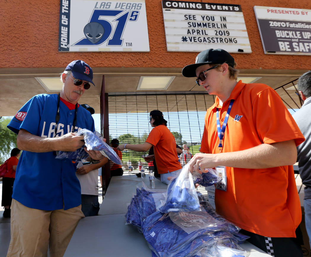 Stephen Davis gets a T-shirt from Raef Bishop before the Las Vegas 51s final game ever at Cashman Field in Las Vegas Monday, Sept. 3, 2018. The team will move to a new stadium in Summerlin next se ...