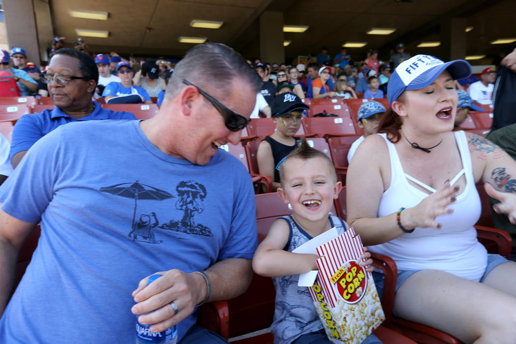 Caleb Williams, 4, with his parents Scott and Mical-Anne before the Las Vegas 51s final game ever at Cashman Field in Las Vegas Monday, Sept. 3, 2018. The team will move to a new stadium in Summer ...
