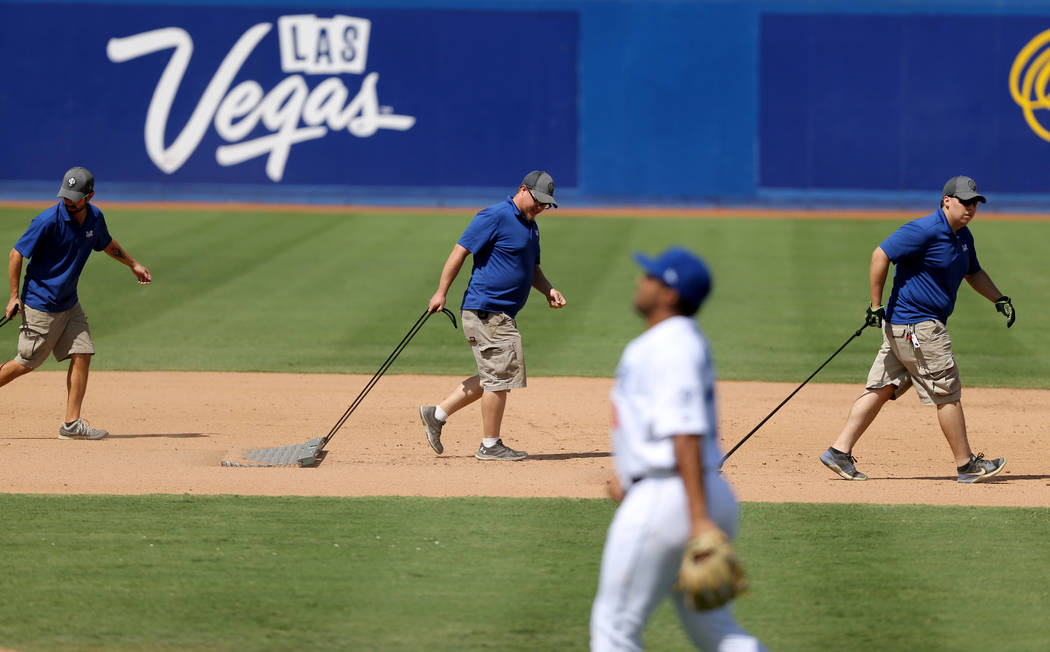 The ground crew works the infield between innings during the Las Vegas 51s final game ever at Cashman Field in Las Vegas Monday, Sept. 3, 2018. The team will move to a new stadium in Summerlin nex ...
