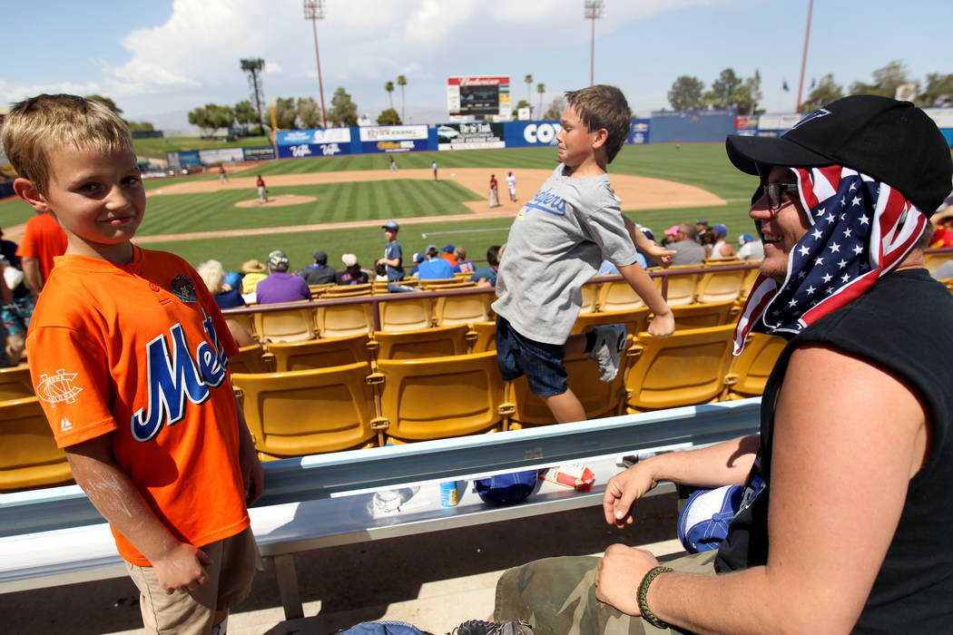 Clint Adams, right, with his sons Liam Adams, 8, left, and Shawn Adams, 11, during the Las Vegas 51s final game ever at Cashman Field in Las Vegas Monday, Sept. 3, 2018. The team will move to a ne ...
