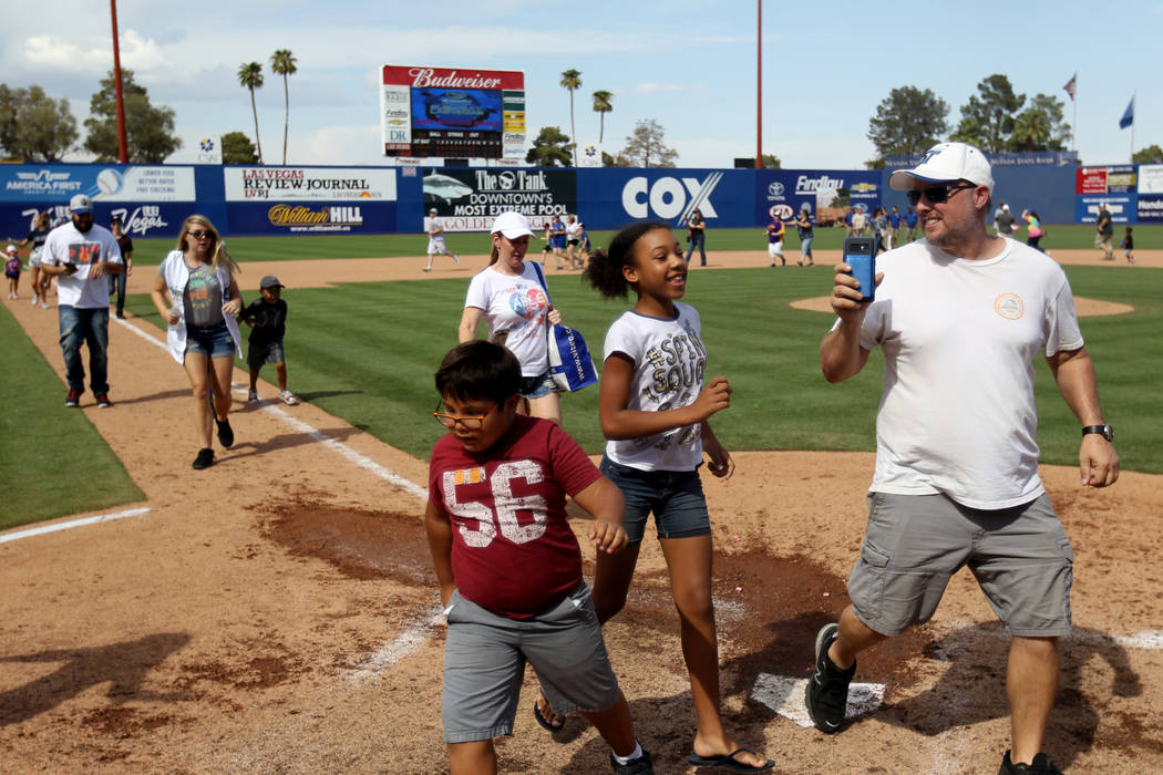 Las Vegas 51s fans run the bases after the final game ever at Cashman Field in Las Vegas Monday, Sept. 3, 2018. The team will move to a new stadium in Summerlin next season. K.M. Cannon Las Vegas ...